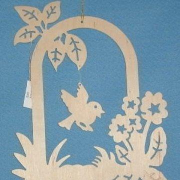Fensterbild Vogel im Blumenkranz