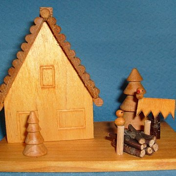 Räucherhaus mit Vögel am Futterhaus
