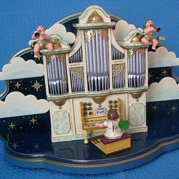 Orgel mit kleiner Wolke und Spielwerk
