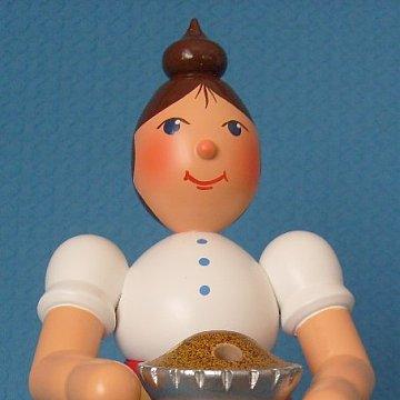 Rauchfrau mit Kuchen