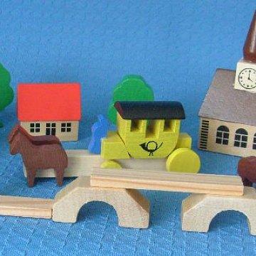 Dorf mit Postkutsche
