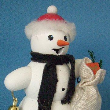 Schneemann mit Geschenkesack