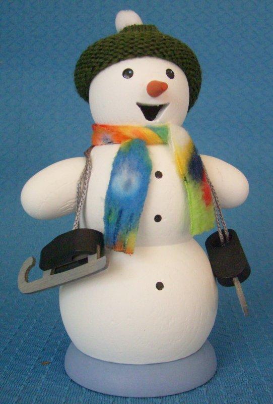 Schneemann mit Schlittschuh